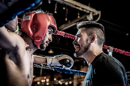 Boxing Coach Training the Boxer Ringside